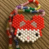 Hello Kitty Wearing A Deadmau5 Hat On Clear Rainbow Necklace With UV Beads