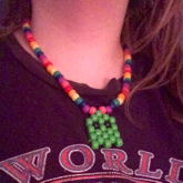 Lighter Green Pacman Ghost On Rainbow Necklace