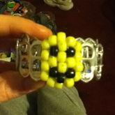 Kandi Smile Face Charm On A Soda Tab Bracelet