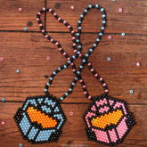 Pink Vs. Blue Halo Mask Necklaces