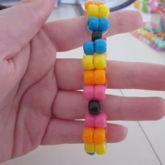 Alternating Black, Blue, Yellow, Orange, And Pink Ladder Stitch