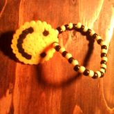 Perlerbead Smily Face On A Yelloy And Black Singel