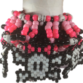 UFO With 5 Skulls With Pink Bows