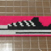A Sneaker With Pink Border