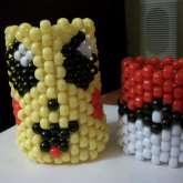 Pikachu's Face And A Pokeball(: